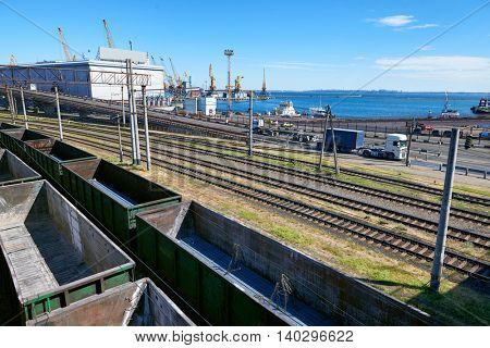 infrastructure of industrial cargo seaport with railroad car, truck and ship, road over the bridge