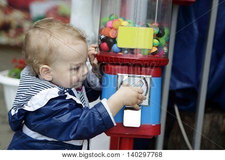 Toddler Using Vending Toys