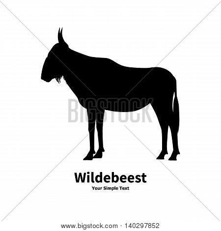 Vector illustration of black silhouette of wildebeest on the isolated white background. Wildebeest side view profile.