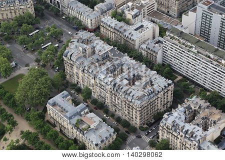 PARIS, FRANCE - MAY 12, 2015: It is aerial view of a typical Parisian city house near Eifel tower.