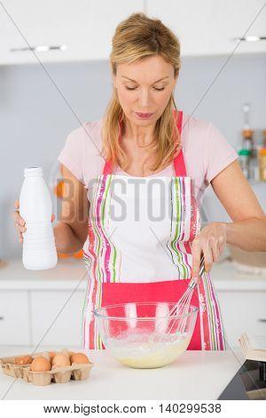 preparing dough mixing ingredients