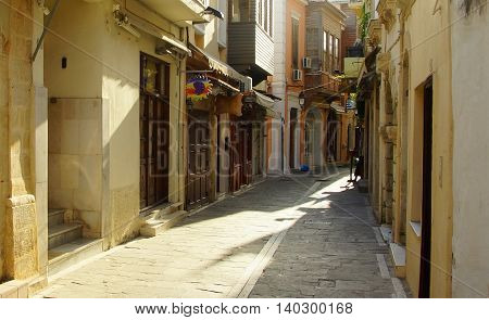 Morning in Rethymno. The narrow and quiet street in the historic city