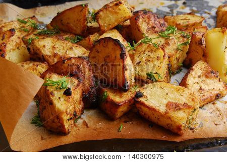 close up of the roasted potatos on paper