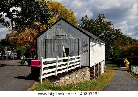 Lancaster Pennsylvania - October 18 2015: Old Farming Equipment shed / Corn Barn at the Amish Farm and House Museum