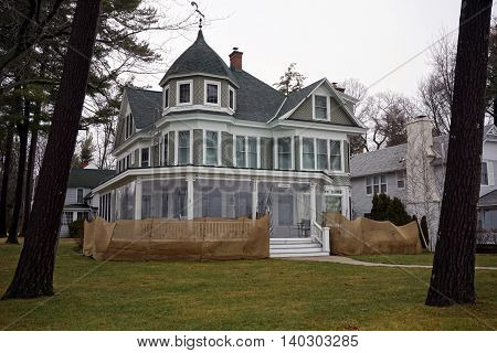 WEQUENTONSING, MICHIGAN / UNITED STATES - DECEMBER 22, 2015: A large elegant home, christened Tilted Pines, on Beach Drive in Wequetonsing, Michigan.