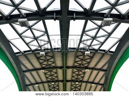 The design of the roof ceiling of the curve metal frame and glass filling. Symmetric perspective view.