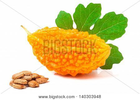 yellow momordica with leaf and seeds isolated on white background.