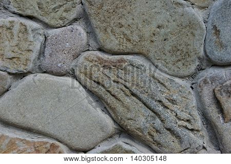 Texture of grey stone as background close up.