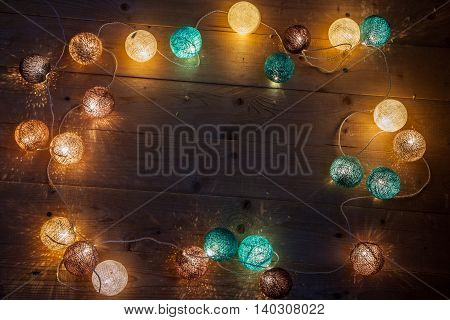 Electric garland with wire balls on wood boards