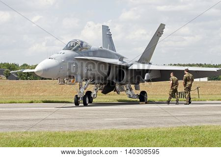 VOLKEL, NETHERLANDS - JUNE 15:Parking fighter jet and two pilots during the Royal Netherlands Air Force Day