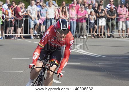 Apeldoorn, Holland, May 6, 2016:Cyclist from team Lotto suadal drive a fast curve in the prologue of the Giro the italia spectators along the course