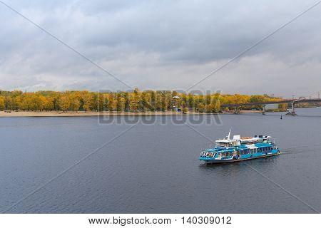 Tourist pleasure boats on the Dnepr River and river shore autumn. Kiev. Ukraine