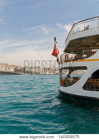 Passenger ship in Istanbul on the Golden Horn. Blue sky and cloud on buckground.