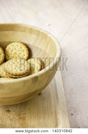 wheat sandwich cookies with chocolate filling cream round shape on wooden board