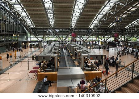 HAMBURG; GERMANY; JULY 27 2016: passenger terminal with check-in and baggage claim at the international airport Hamburg Fuhlsbüttel in Germany
