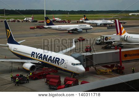 HAMBURG; GERMANY; JULY 27 2016: Aircrafts of Ryanair and Lufthansa on the runway at the terminal in the international airport Hamburg Fuhlsbüttel the oldest and fifth largest airport in Germany