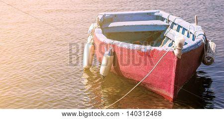 Little Boat Adrift On The Water