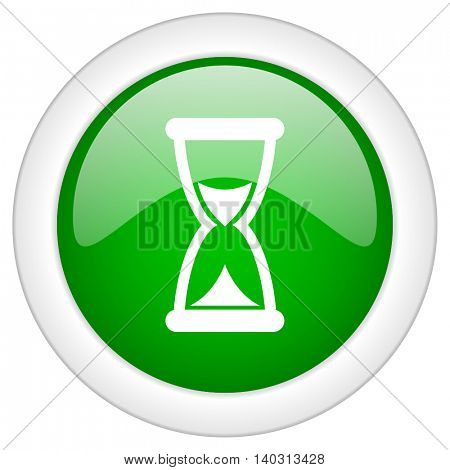 Green glossy web hourglass vector icon isolated on white bacground