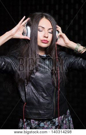 Young Brunette Posing With Headphones