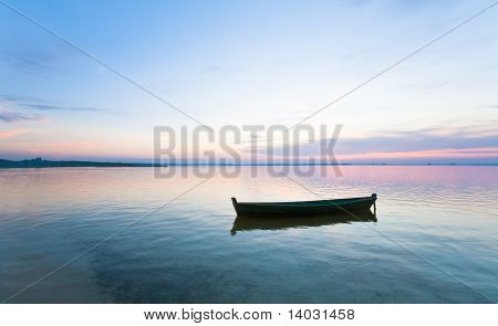Sunset And Boat On Summer Lake Bank