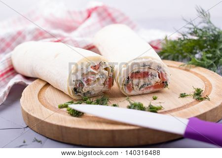 Roll From Red Fish With Cheese And Greens. With The Selective Depth Of Sharpness