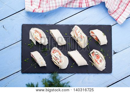 Roll From Red Fish With Cheese And Greens
