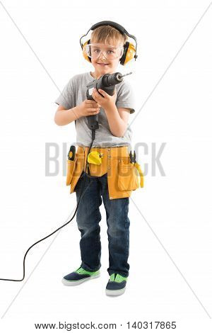Portrait Of Happy Boy Holding Drilling Machine Over White Background