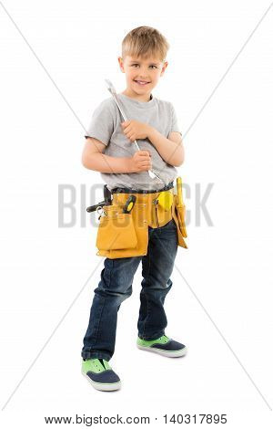 Portrait Photo Of Smiling Boy Holding Spanner