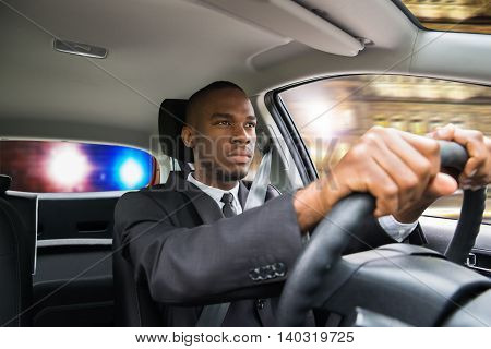 Young African Businessman Chased By Police While Driving Car