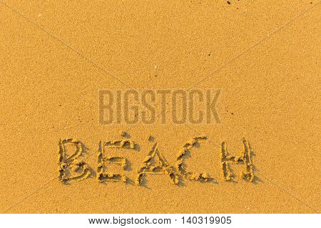 Beach - inscription on golden sand.