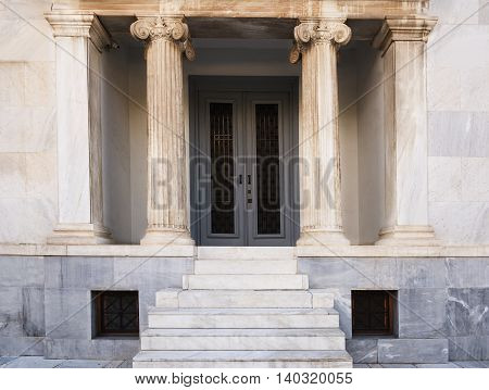 white marble staircase and the entrance to the building