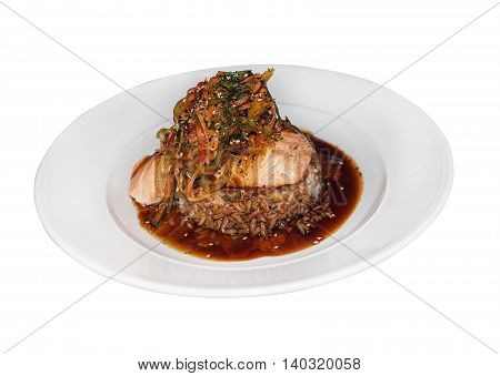 salmon with vegetables and rice in soy sauce isolated on white background