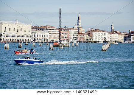 ITALY VENICE - November 20 2013: Pleasure boat swam to the pier.