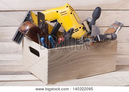 Construction tools on wooden table with sawdust. Joiner carpenter workplace top view. Copy space for text.