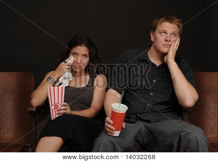 Couple on a date at the movies with a bored man and a crying woman