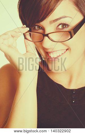Smiling beautiful woman wearing eyeglasses