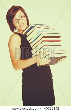 Pretty woman carrying school books