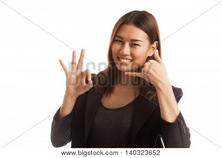 Young Asian Woman Show With Phone Gesture And Ok Sign.