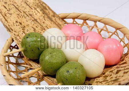 Three colors dumplings wrapped in bamboo basket and Takesasa in Hinamatsuri of Japan