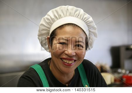Happy and smiling Asian woman chef portrait