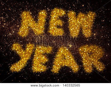 gold glitter abstract background with word new year