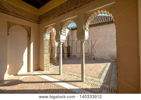 Malaga, Andalucia, Spain - April 16, 2016: inside with portico and columns in Alcazaba. The place is declared Unesco World Heritage Site.