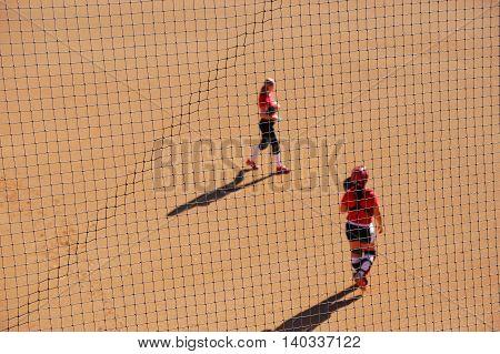 women play softball, selective focus on the net
