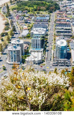 Mount Maunganui, New Zealand - November 8, 2012; Mount Maunganui from mountain summit resort area with apartment buildings dominating the landscape close to base of mountain