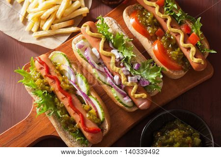 grilled hot dogs with vegetables ketchup mustard