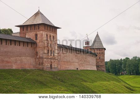 Veliky Novgorod. View of the Kremlin wall, ditch and towers.