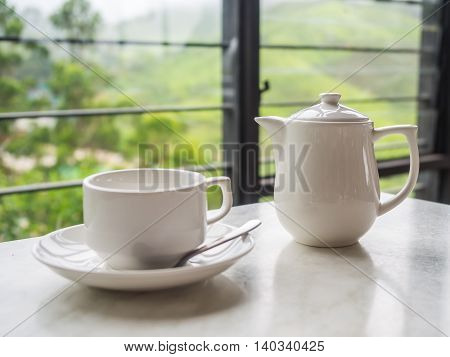 White teapot and tea cup on the table at Boh Tea Plantation Cameron Highlands Malaysia