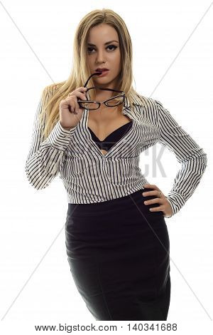 Stylish trendy young woman in a striped shirt and black skirt holding glasses at lips isolated on white. Sexy lady