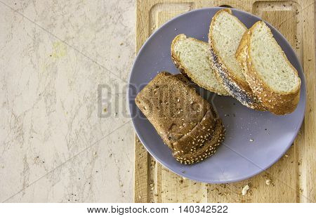 rye bread with prunes and sesame seeds and long loaf with sesame and poppy seeds