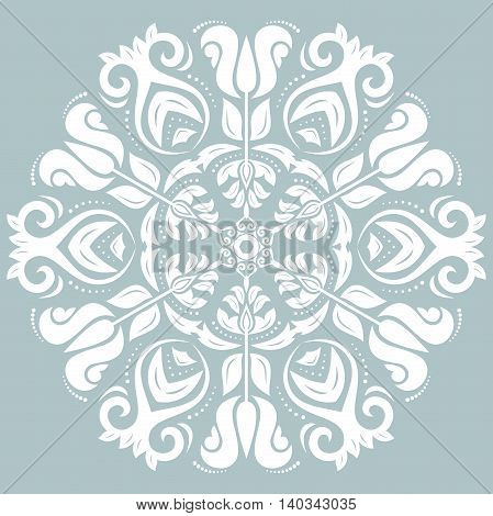 Oriental vector round pattern with arabesques and floral elements. Traditional classic ornament. Light blue and white pattern